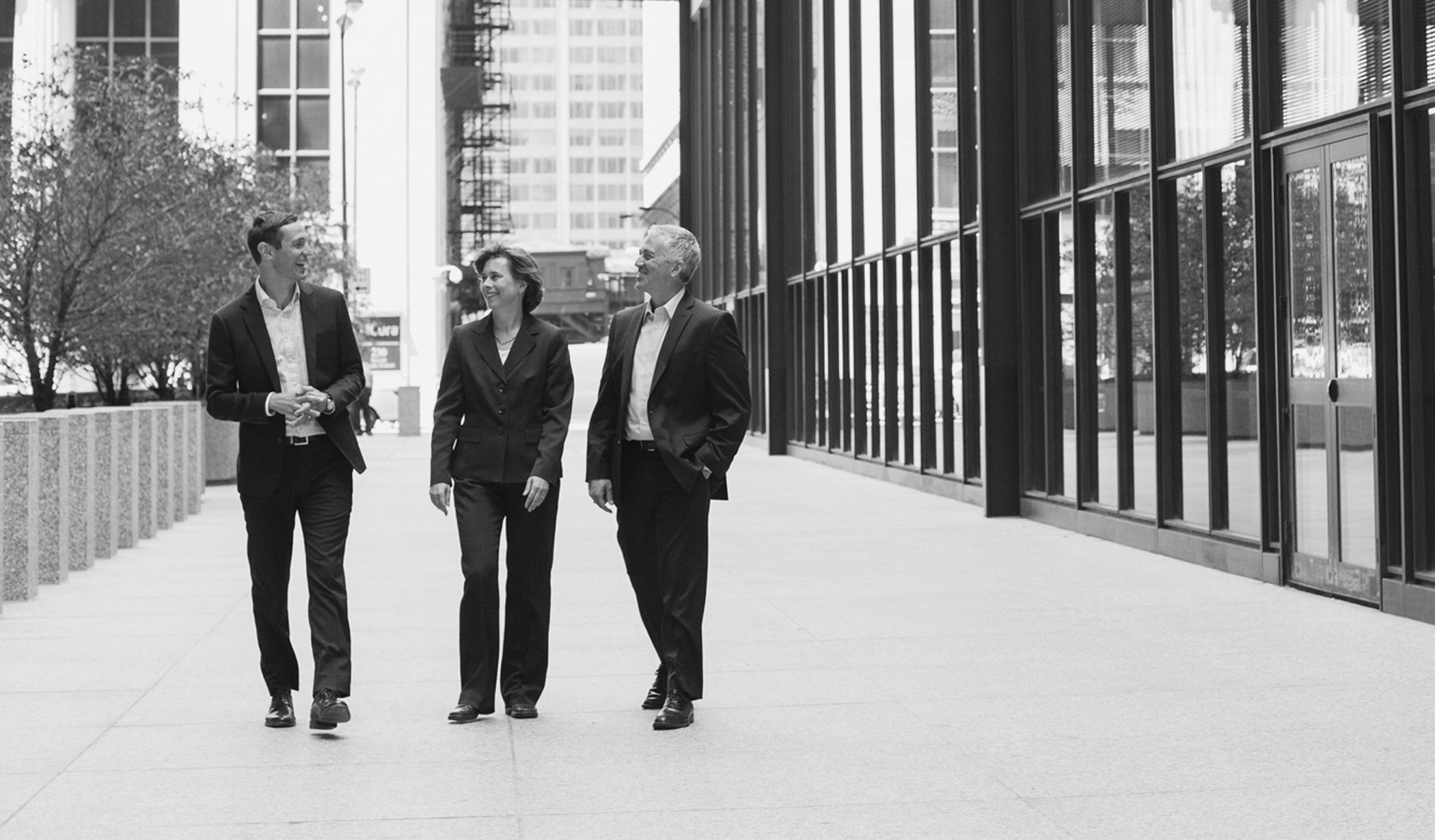 Attorneys Wagenmaker, Oberly, & Winters walking down Chicago street